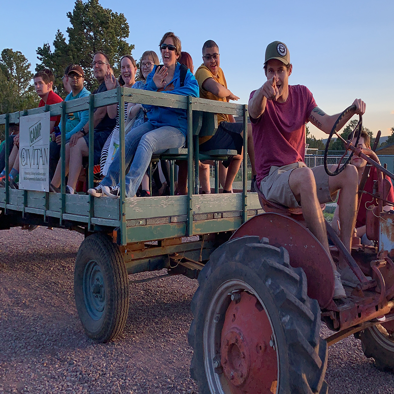 Campers enjoying a tractor ride at Camp.