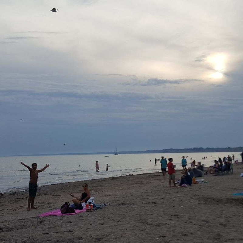 Lake Erie at dusk with people enjoying the sunset