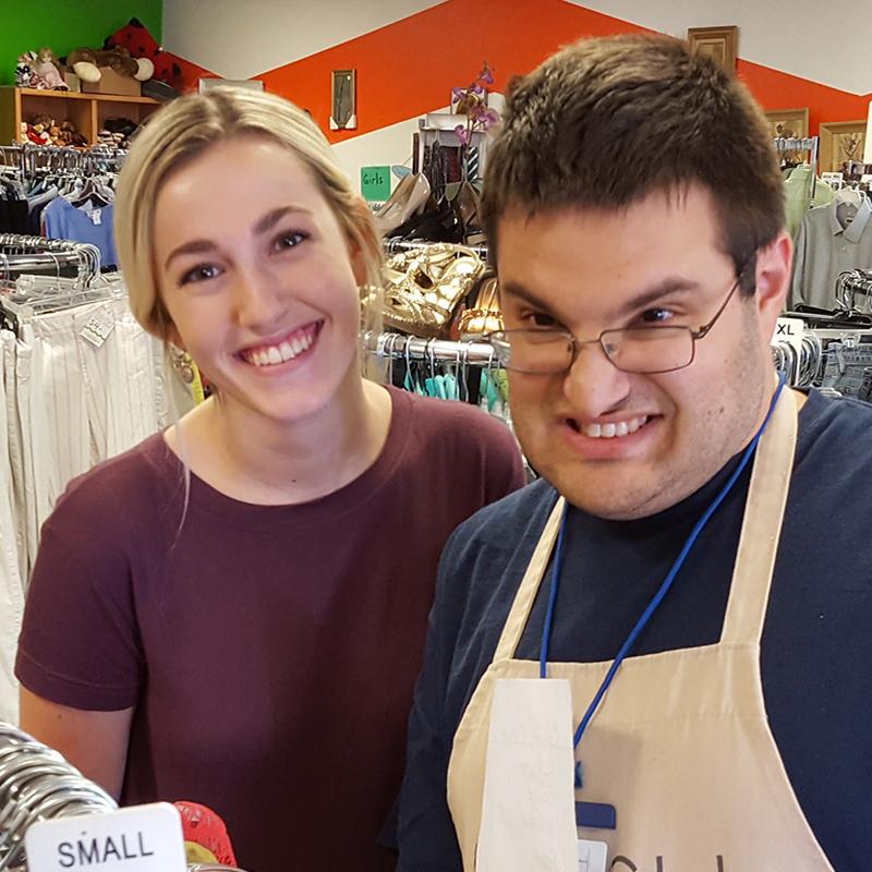 Civitan staff with member at the Flerish thrift store